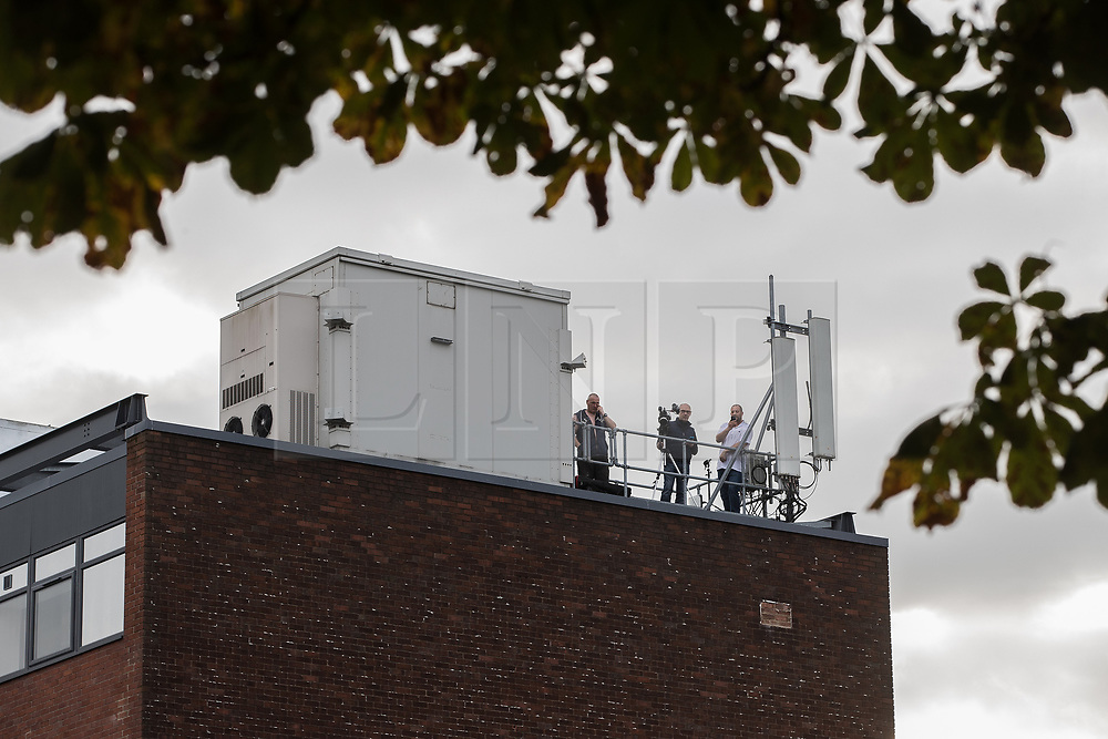 © Licensed to London News Pictures . 18/09/2017 . Stockport , UK . Media filming the arrival of Everton footballer Wayne Rooney from a building roof overlooking Stockport Magistrates Court where Rooney faces a drink-driving charge . The former England and Manchester United captain was arrested by police whilst driving in Wilmslow in Cheshire during the early hours of 1st September . Photo credit: Joel Goodman/LNP