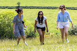 Licensed to London News Pictures. 05/06/2021. Dorking, UK. After the heavy rains yesterday, school friends from Kingston (L to R) Malti Vaghela, Izzy Khan and Nadia Saif all 30 enjoy a walk in the warm sunshine on Box Hill in Surrey as the fine June weather continues. The Met Office have forecast very warm weather for the South East and London with temperatures predicted to hit up to 24c for next week. Photo credit: Alex Lentati/LNP