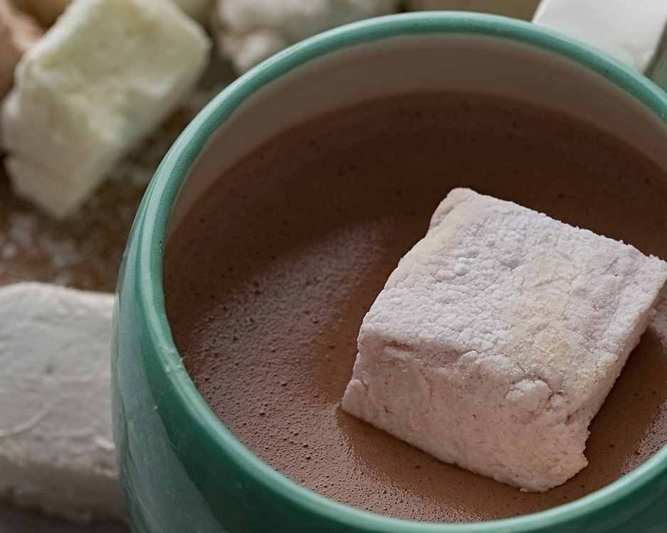Strawberry-flavored gourmet marshmallow floating atop a rich and creamy hot chocolate.
