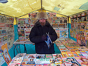 Newsman selling magazines and newspapers in a tent during temperatures around -30 degrees Celsius in the city center of Yakutsk. Yakutsk is a city in the Russian Far East, located about 4 degrees (450 km) below the Arctic Circle. It is the capital of the Sakha (Yakutia) Republic (formerly the Yakut Autonomous Soviet Socialist Republic), Russia and a major port on the Lena River. Yakutsk is one of the coldest cities on earth, with winter temperatures averaging -40.9 degrees Celsius.