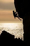 Sam Ecenina climbs a sport route at  Horseshoe Point in Salt Point State Park, Sonoma Coast, California.