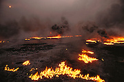 The burning greater Al Burgan oil fields in Kuwait after the end of the Gulf War in May of 1991. More than 700 wells were set ablaze by retreating Iraqi troops creating the largest man-made environmental disaster in history.