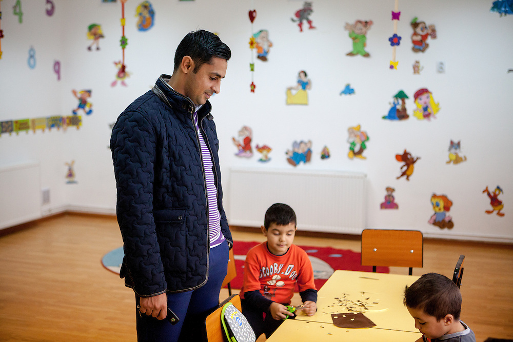 Roma activist Marius Tudor with a group of children - Roma and Non Roma - at the new reconstructed local kindergarten in Marginenii de Jos.