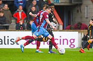 Adam Hammill of Scunthorpe United (47) shoots during the EFL Sky Bet League 1 match between Scunthorpe United and Bradford City at Glanford Park, Scunthorpe, England on 27 April 2019.