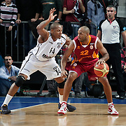 Besiktas's David Hawkins (L) and Galatasaray's Jamon Lucas Gordon (R) during their BEKO Basketball League match Besiktas between Galatasaray at the Sinan Erdem Arena in Istanbul at Turkey on Saturday, December, 17, 2011. Photo by TURKPIX