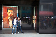 Prada store at Westfield Shopping Centre in Stratford in East London, UK. Exclusive stores selling luxury goods are common here as it seems there is a lot of wealth around to afford expensive fashion.