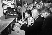 """Jamboree on the Air for Catholic Boy Scouts of Ireland. Picture shows Rev. Fr. James A. Stone, C.C. Donybrook, the well-known amateur radio operator, and National Organiser of the """"Jamboree on the Air"""" for the Federation of Irish Scout Associations, calls """"C-O Jamboree"""" assisted by Scouts and Macomh of his Donnybrook and Raheny units, Catholic Boy Scouts of Ireland..22.10.1966"""