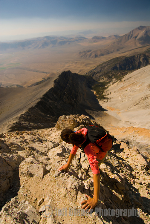 """A young woman climbs down from """"Chicken Out Ridge"""" on Borah Peak in the Lost River Range, Idaho."""