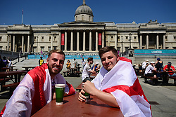 © Licensed to London News Pictures. 13/06/2021. London, UK. England fans gather in the Fan Zone at Trafalgar Square in central London for England's opening game of the 2020 European Championship against Croatia. Today's event is attended by key workers from around the UK. . Photo credit: Ben Cawthra/LNP