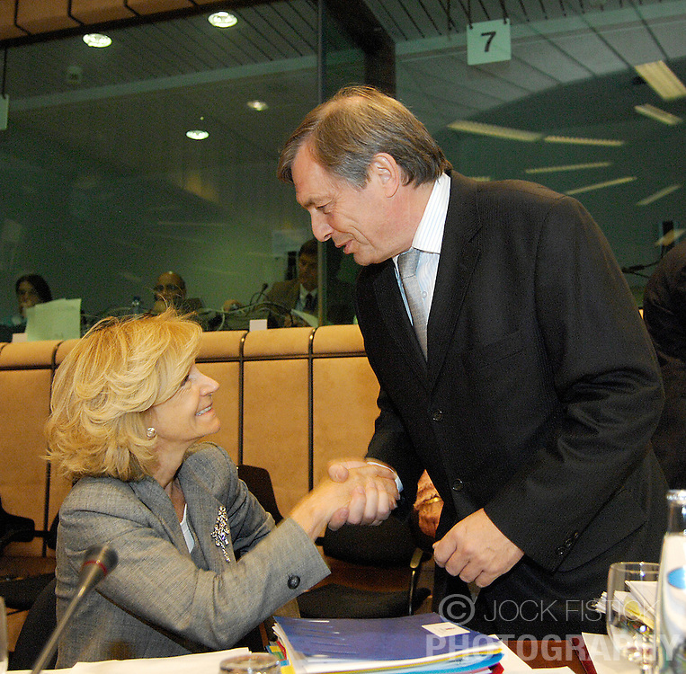 Jeannot Krecke, Luxembourg's minister of economy and foreign trade, speaks with Elena Salgado, Spain's finance minister, during the monthly Eurogroup meeting at the EU council headquarters in Brussels, Belgium, Monday, May, 4, 2009. (Photo © Jock Fistick)