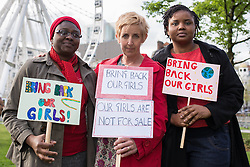 © Licensed to London News Pictures . 06/05/2014 . Piccadilly Gardens , Manchester , UK . L-R Wunmi Shitta (42 from Lagos) , actress Julie Hesmondhalgh and Uju Nwolum (37 from Anambra) (all correct) . Demonstration to highlight the plight of over 200 Nigerian girls kidnapped by Islamist Extremist group Boko Haram as today the group's leader , Abubakar Shekau , has said he will sell the girls in to slavery . Photo credit : Joel Goodman/LNP