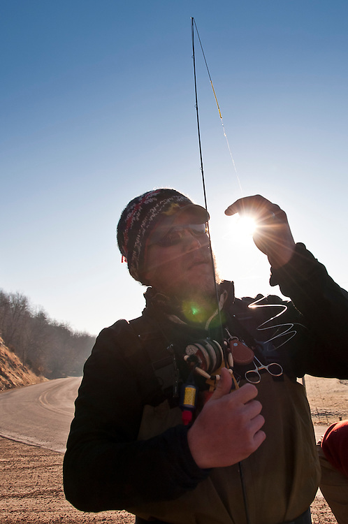 A fisherman rigs up for fly fishing in the Driftless Area of Wisconsin.
