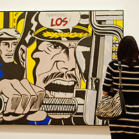 London, UK - 18 February 2013: a woman stands in front of Torpedo...Los!' during the  'Lichtenstein: A Retrospective' exhibition that opens at Tate Modern in London on the 21st of February. The exhibition is the first major Lichtenstein retrospective for twenty years, bringing together over 125 of the artist's most definitive paintings and sculptures. Built on new research and scholarship, the exhibition reassesses Lichtenstein's work and his enduring legacy.