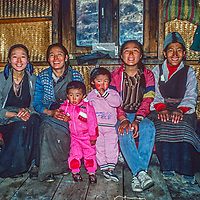 Three generations of the family of the late Sherpa Pasang Kami poses in the kitchen of their lodge in Namche Bazar.  Famed Sherpani Namdu is 2nd from left.