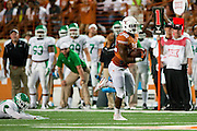 AUSTIN, TX - AUGUST 30:  Johnathan Gray #32 of the Texas Longhorns breaks free against the North Texas Mean Green on August 30, 2014 at Darrell K Royal-Texas Memorial Stadium in Austin, Texas.  (Photo by Cooper Neill/Getty Images) *** Local Caption *** Johnathan Gray