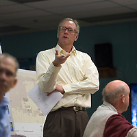 012115      Cayla Nimmo<br /> <br /> Thomas Parker, sensibility consultant from CDM Smith, answers questions from Gallup residents about proposed options for curbside recycling pick up at an open meeting held at the North Side Senior Center in Gallup Wednesday.
