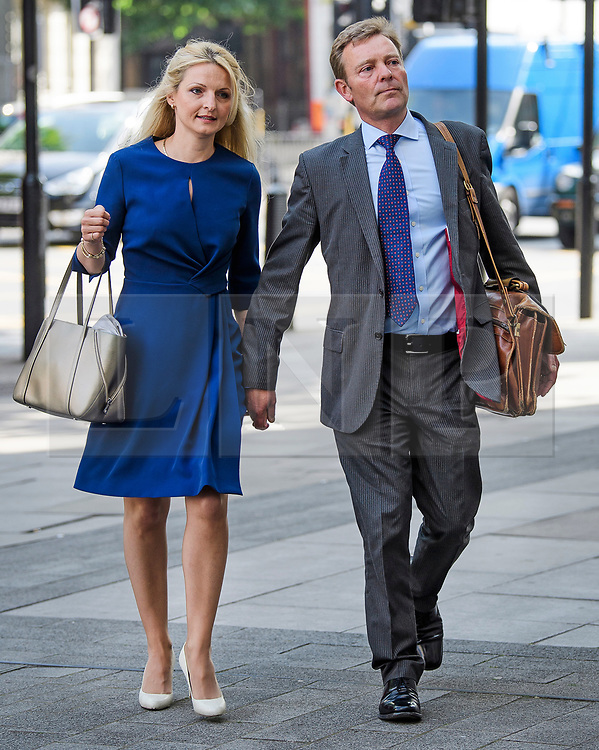 © Licensed to London News Pictures. 04/07/2017. London, UK. Conservative MP CRAIG MACKINLAY arrives at Westminster Magistrates Court in London with his wife KATI MACKINLEY, where he faces charges relating to his 2015 general election expenses. Craig Mackinlay, Nathan Gray and Marion Little have each been charged with offences under the Representation of the People Act 1983. Photo credit: Ben Cawthra/LNP