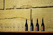 In the tasting room, on a shelf, glasses and bottles of Domaine Viret, Emergence, Les Colonnades, Mareotis Domaine Viret, Saint Maurice sur Eygues, Drôme Drome France, Europe