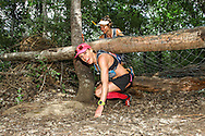 Chantel Neinaber slips under a fallen tree while Katja Sogot waits behind her, on their way to victory in the Womens's Team race on Stage 3 of the Fairview Dryland Traverse, on the 6th of November 2016.<br /> <br /> <br /> Photo by: Oakpics/Fairview Dryland Traverse/SPORTZPICS<br /> <br /> <br /> {dem16gst}