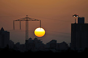 High voltage power line pylon at sunset