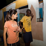 Peace Corps volunteer Rachael stops in her tracks in surprise, hearing her name mentioned on the radio for the good work she's doing in Koumbadiouma. Kolda, Senegal.