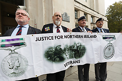 © Licensed to London News Pictures. 05/10/2018. London, UK. Members of the pressure group, Justice for Northern Ireland (NI) Veterans stage a picket protest outside the Ministry of Defence in Whitehall as part of a national day of protest to demonstrate against what they claim is a witch-hunt to prosecute former service personnel who served during the conflict in northern Ireland. Photo credit: Vickie Flores/LNP