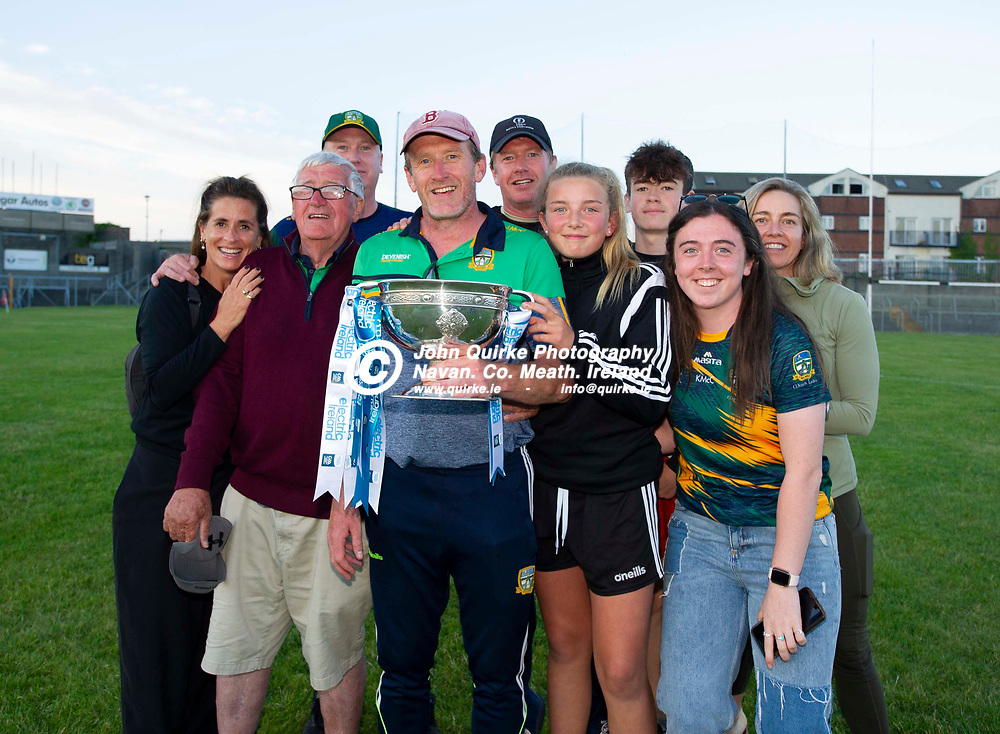 30-06-21. Meath v Offaly - Leinster MFC Final 2020 at TEG Cusack Park, Mullingar.<br /> McCarthy family from left, Brenda, Cathal, Justin (Back), John, Paul, Sarah, Charles, Kate and Evelyn celebrating with the Larry Murphy Cup.<br /> Photo: John Quirke / www.quirke.ie<br /> ©John Quirke Photography, 16 Proudstown Road, Navan. Co. Meath. (info@quirke.ie / 046-9028461 / 087-2579454).