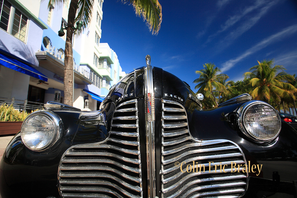 I vintage automobile is parked along Ocean Drive on Miami Beach in Florida. Colin Braley/Photo