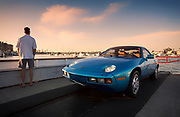 Image of a Minerva Blue 1978 Porsche 928 on the ferry to Balboa Island, California, America west coast by Randy Wells