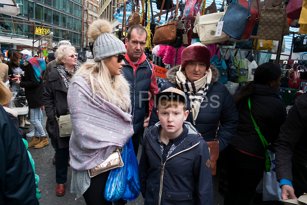 Scene along Petticoat Lane market on a Sunday in London, England, United Kingdom. Petticoat Lane Market is a fashion and clothing market in the East End of London. It consists of two adjacent street markets. Wentworth Street Market is open six days a week and Middlesex Street Market is open on Sunday only. (photo by Mike Kemp/In Pictures via Getty Images)
