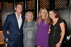 Left to right, JONNY SAYLE, MALY SAYLE, EMMA SAYLE and GEORGIE SAYLE at a party to celebrate the publication of Behind The Mask by Emma Sayle held at The Playboy Club, 14 Old Park Lane, London on 23rd April 2014.