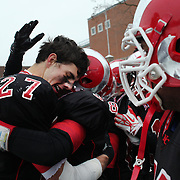 Sterling Guynn, (left), New Canaan, celebrates with team mates after a touchdown during the New Canaan Rams Vs Darien Blue Wave, CIAC Football Championship Class L Final at Boyle Stadium, Stamford. The New Canaan Rams won the match in snowy conditions 44-12. Stamford,  Connecticut, USA. 14th December 2013. Photo Tim Clayton