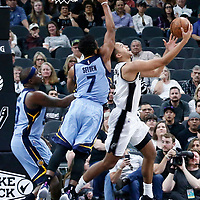 04 April 2017: San Antonio Spurs guard Bryn Forbes (11) goes for the reverse layup past Memphis Grizzlies guard Wayne Selden (7) during the San Antonio Spurs 95-89 OT victory over the Memphis Grizzlies, at the AT&T Center, San Antonio, Texas, USA.