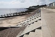 Concrete steps. groynes and sea wall. Coastal defences, Felixstowe, Suffolk, England