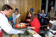 Man 34 served Christmas dinner by volunteers church soup kitchen.  Minneapolis Minnesota USA