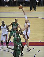 Cleveland's Zydrunas Ilgauskas shoots over the Boston defense.