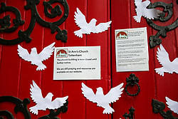 © Licensed to London News Pictures. 07/06/2020. London, UK. Paper doves stuck at the entrance to the St Ann's Church, South Tottenham, north London which has been closed since March 2020 following COVID-19 lockdown. The government is expected to announce that places of worship in England can open for private prayers from 15 June. Photo credit: Dinendra Haria/LNP