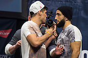 Vicente Luque and Belal Muhammad face off during the UFC 205 weigh-ins at Madison Square Garden in New York, New York on November 11, 2016.  (Cooper Neill for The Players Tribune)