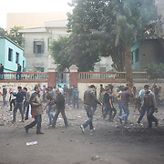 Egyptian protestors walk towards the security forces checkpoint near Tahrir Square in central Cairo.