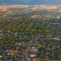 An aerial view of Bozeman, Montana, looking south towards the Gallatin Range and Hyalite Mountains.  Montana State University is in the upper right of downtown.