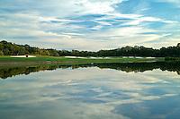 Beautiful skies surround Fairway an Green across water