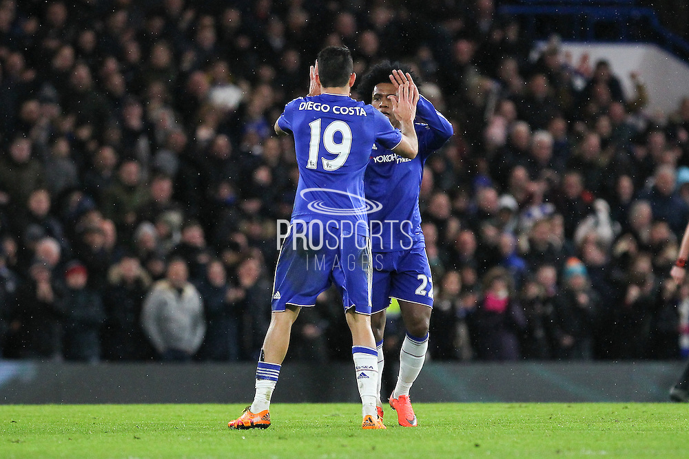 Chelsea's Diego Costa is congratulated by Chelsea's Willian after his goal during the Barclays Premier League match between Chelsea and Manchester United at Stamford Bridge, London, England on 7 February 2016. Photo by Phil Duncan.