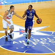 Anadolu Efes's Dontaye Draper (L) and Real Madrid's Jaycee Carrol (L) during their Turkish Airlines Euroleague Basketball Group A Round 5 match Anadolu Efes between Real Madrid at Abdi ipekci arena in Istanbul, Turkey, Thursday, November 14, 2014. Photo by Aykut AKICI/TURKPIX