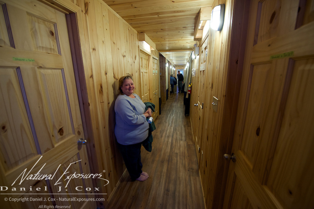 Lynn waits for the washroom in her bunkhouse known as Laperouse at Tundra Buggy Lodge, Cape Churchill, Manitoba.
