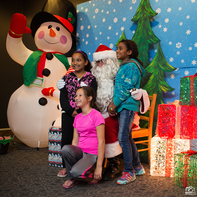 Children take photos and share their Christmas gift wish list with Santa Claus during the Milpitas Christmas Tree Lighting Ceremony at Milpitas City Hall, in Milpitas, California, on December 1, 2013. (Stan Olszewski/SOSKIphoto)
