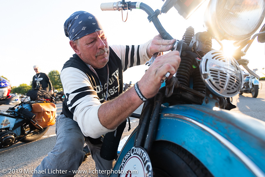 Chris Tribbey working on his 1947 Harley-Davidson WL Flathead during the Cross Country Chase motorcycle endurance run from Sault Sainte Marie, MI to Key West, FL (for vintage bikes from 1930-1948). Stage 4 saw a 315 mile ride from Urbana, IL to Bowling Green, KY USA. Monday, September 9, 2019. Photography ©2019 Michael Lichter.
