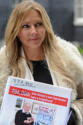 "© Licensed to London News Pictures. 26/01/2017. London, UK. Carol Vordeman, TV personality, prepares to hand in a petition with 237,800 signatures at number 10 Downing Street.  The petition calls for George ""Johnny"" Johnson, aged 95, who took part in the WW2 Dambusters operation, to receive a knighthood.  Photo credit : Stephen Chung/LNP"