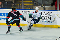 KELOWNA, CANADA - OCTOBER 10:  Cayde Augustine #5 of the Kelowna Rockets stick checks Zack Andrusiak #20 of the Seattle Thunderbirds on October 10, 2018 at Prospera Place in Kelowna, British Columbia, Canada.  (Photo by Marissa Baecker/Shoot the Breeze)  *** Local Caption ***