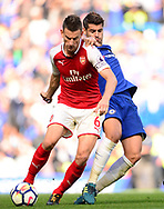 Laurent Koscielney of Arsenal battles with Alvaro Morata of Chelsea. Premier league match, Chelsea v Arsenal at Stamford Bridge in London on Sunday 17th September 2017.<br /> pic by Andrew Orchard sports photography.