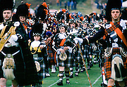 Traditional Scottish band in tartan kilts marching at the Braemar Royal Highland Gathering, the Braemar Games in Scotland